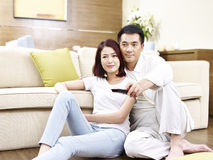 Asian couple watching TV Royalty Free Stock Photo