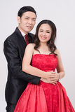 Asian couple wearing evening gown and dress. Royalty Free Stock Photo
