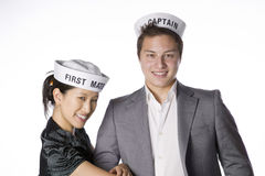 Asian couple wearing sailor  hats Royalty Free Stock Photography