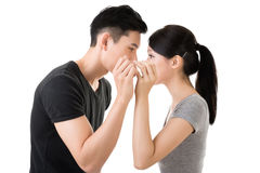 Asian couple whisper. Young Asian couple whisper, closeup portrait royalty free stock photo