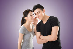 Asian couple whisper. Young Asian couple whisper, closeup portrait stock photography