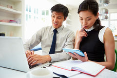 Asian Couple Working From Home Looking At Personal Finances Royalty Free Stock Photography