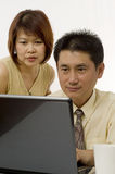 Asian couple working together Stock Image