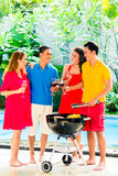 Asian couples having barbecue and drinking wine Stock Images