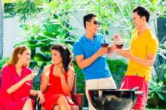 Asian couples having barbecue and drinking wine Royalty Free Stock Photo