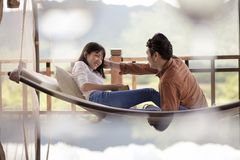 Asian couples relaxing vacation time on cradle royalty free stock photos