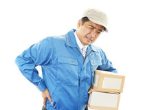 Asian courier with backache Royalty Free Stock Images