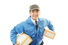 Asian courier delivering a package Royalty Free Stock Image