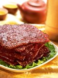 Asian cuisine. BBQ meat serve with tea Stock Image
