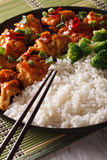 Asian cuisine: chicken in sauce with rice and broccoli closeup. Royalty Free Stock Photos