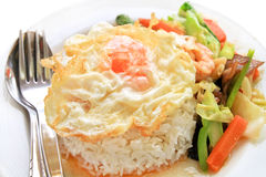 A fried egg on rice. Royalty Free Stock Photo