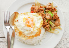 A fried egg on rice. Royalty Free Stock Photography