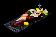 Asian cuisine or Japanese food. Sushi medium set on wooden plate Stock Image