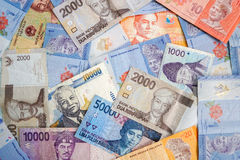 Asian currency banknotes. Pile of different asian currency banknotes Royalty Free Stock Image