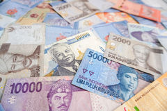 Asian currency banknotes. Pile of different asian currency banknotes Stock Images