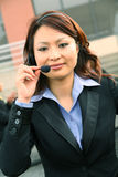 Asian Customer Service. Pretty asian business woman wearing headset as customer service representative stock photos