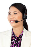 Asian customer service representative. Young Asian customer service representative using headset isolated on a white background Stock Photography