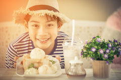 Asian Cute boy enjoying sweet food. Royalty Free Stock Photography