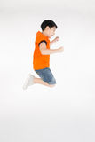 Asian cute boy is jumping with smile face Stock Photography