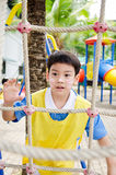 Asian cute boy playing in the park Stock Photos