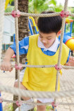 Asian cute boy playing in the park Stock Images