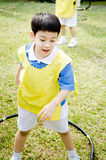 Asian cute boy playing in the park Royalty Free Stock Photos