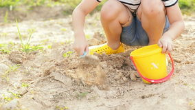 Asian cute boy playing with toys in garden. stock footage