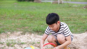 Asian cute boy playing with toys in garden. stock video footage