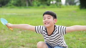 Asian cute boy playing with toys in garden. stock video
