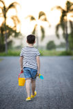 Asian cute boy playing with toys in garden Royalty Free Stock Photo
