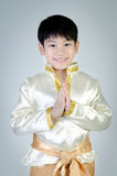 Asian cute boy in thai costume acting Hello Stock Photo