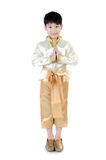 Asian cute boy in thai costume acting Hello Stock Image