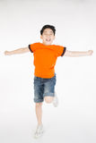 Asian cute child is jumping Stock Image