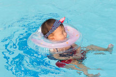 Asian cute eight month baby enjoy swimming pool. Stock Photos