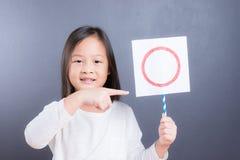 Asian cute girl  hold o refusing sign Stock Photos