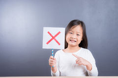 Asian cute girl  hold x refusing sign Royalty Free Stock Photography
