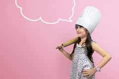 Asian cute girl in chef uniform with copyspace Stock Photography
