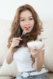 Asian cute girl eating Salad Stock Image
