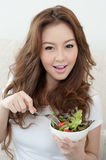Asian cute girl eating Salad. With happy face Stock Image