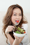Asian cute girl eating Salad. With sexy face Royalty Free Stock Photography