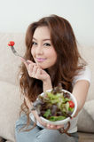 Asian cute girl eating Salad. With happy face Royalty Free Stock Images