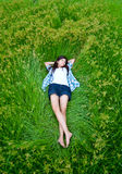 Asian cute girl lying on meadow Royalty Free Stock Photos
