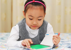 Asian cute girl reading book Royalty Free Stock Photography