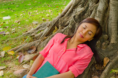 Asian cute girl sleepingin park Royalty Free Stock Photography
