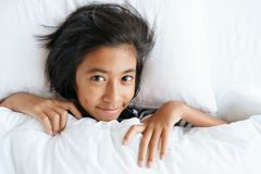 Asian cute girl waking from sleep  the morning. Face of little girl are relaxation after wake up. Asian cute girl waking from sleep on the morning. Face of stock photo