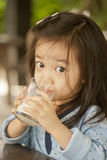 Asian cute little girl drinking milk Royalty Free Stock Photography