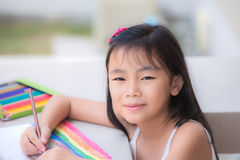 Asian Cute little girl studying Royalty Free Stock Photos