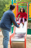 Asian dad and daughter on playground Royalty Free Stock Photography