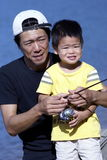 Asian dad and son fishing Royalty Free Stock Images