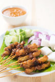 Asian delicacy chicken satay. Delicious chicken satay on wooden dining table, one of famous Malaysian local dishes Stock Photography